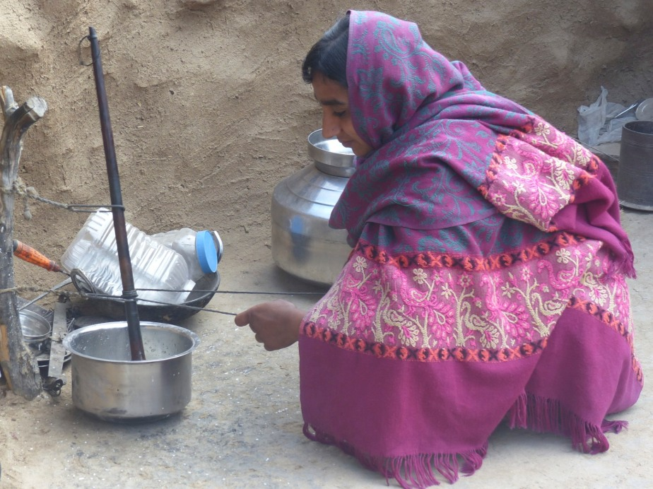 A Bishnoi woman thickening milk.